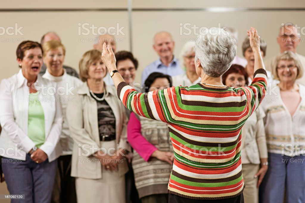 Conductor and Seniors' Choir stock photo