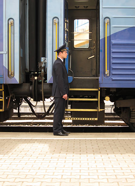 conductor beside entry in train - transport conductor stock photos and pictures