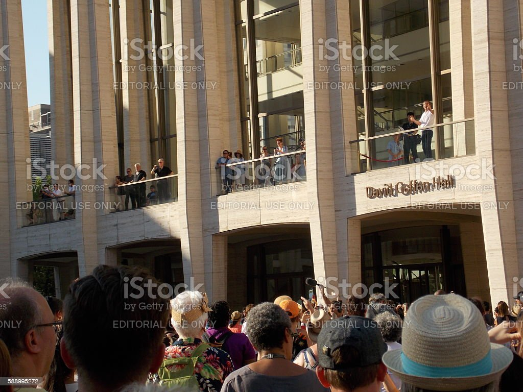 Conductor Leading Outdoor Chorus From Balcony stock photo