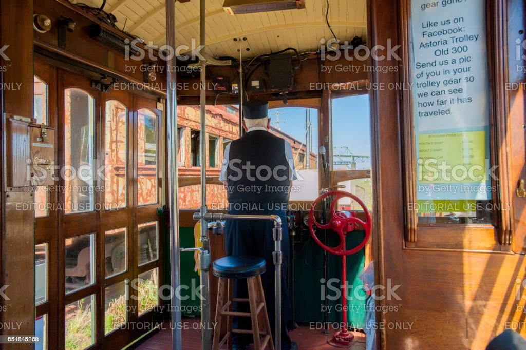 Conductor of Astoria Oregon waterfront trolley stock photo