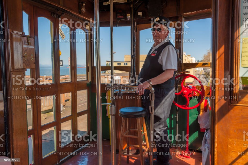 Conductor on Astoria Oregon waterfront trolley stock photo