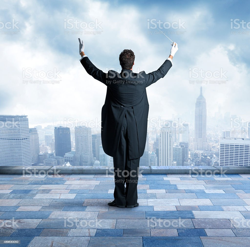 Conductor On Top Of Building In City stock photo