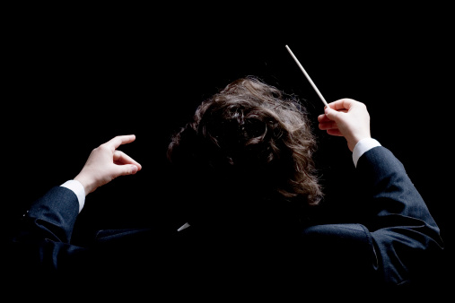 Conductor's hands with a baton