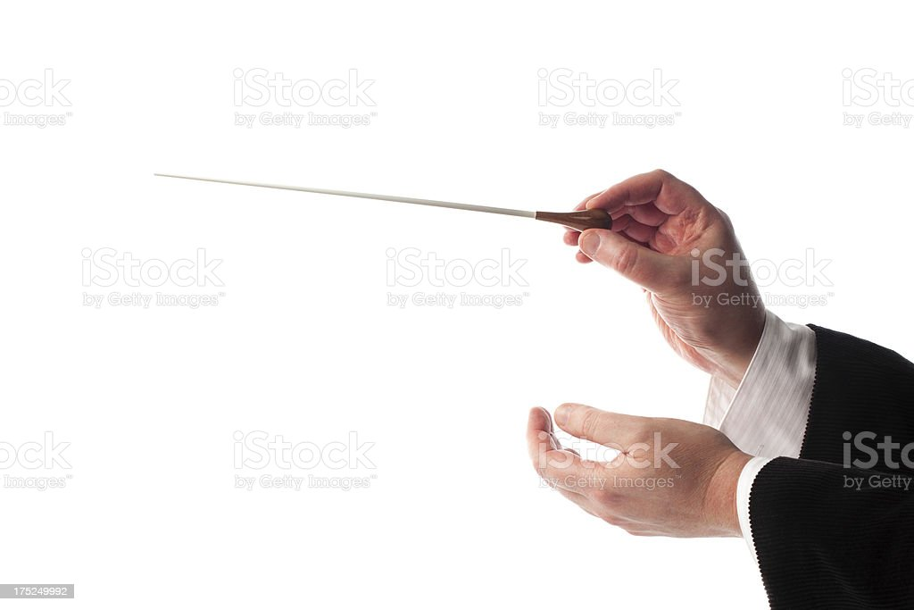 Conductor's hands with a baton stock photo