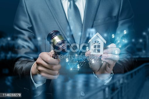 istock Conducts the auction for the sale of real estate . 1146233279
