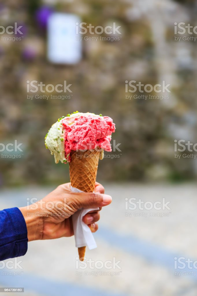 Cone of gelato in hand royalty-free stock photo