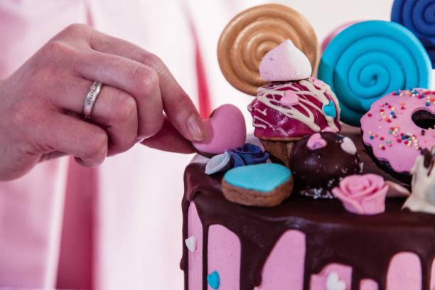 Confectioner decorating a cake stock photo