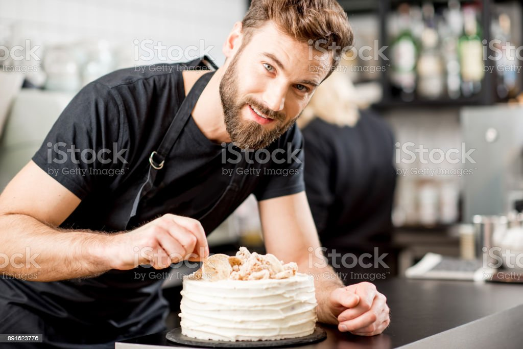 Confectioner decorating a pie stock photo