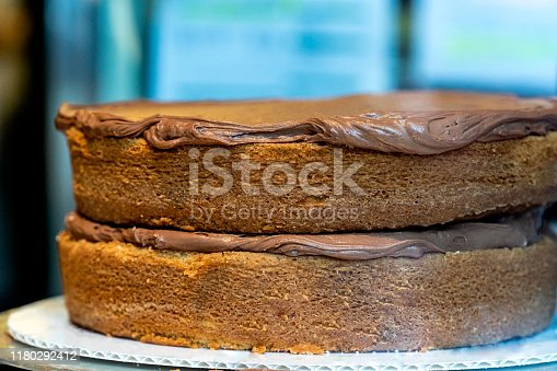 Confectioner decorating chocolate cake Cooking, culinary, bakery, food concept Selective focus