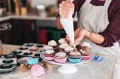 Confectioner decorating Chocolate Muffins