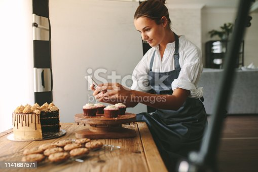 istock Confectioner photographing pastries 1141687571