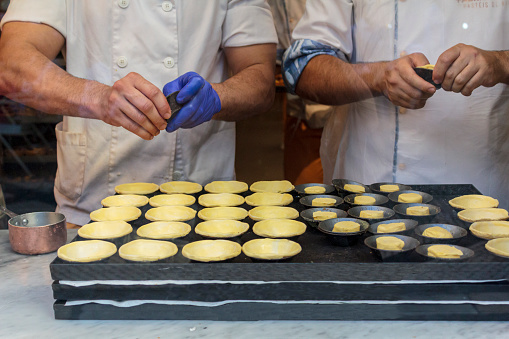 Confectioners making dough for the famous Portuguese cake