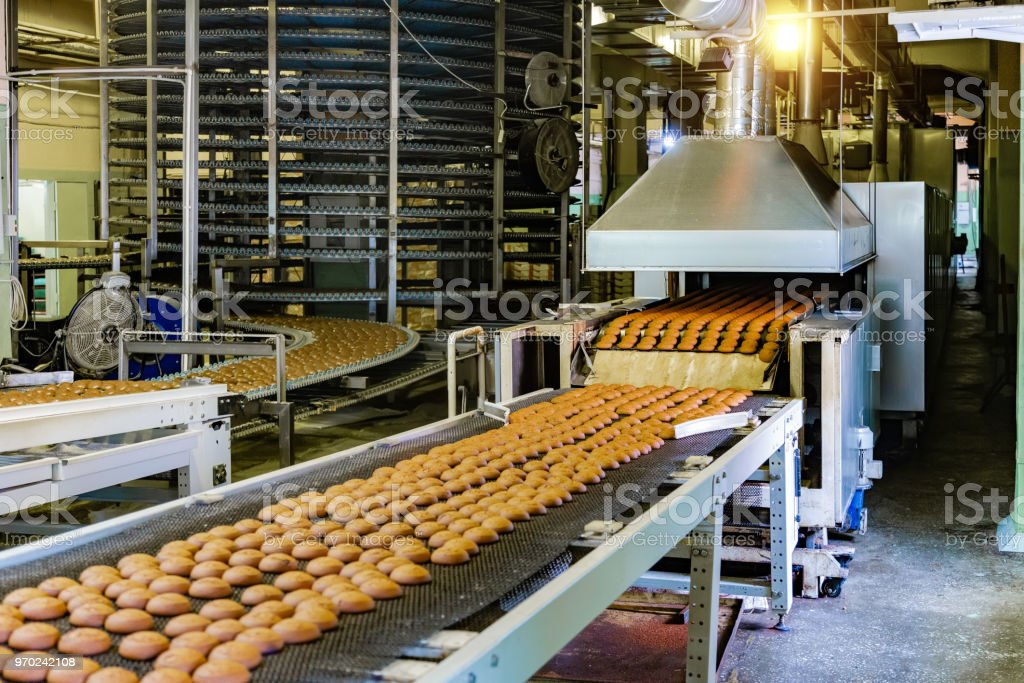 Confectionery factory. Production line of baking cookies. stock photo