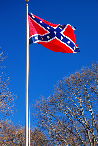 The controversial Confederate battle flag flies over a Civil War Cemetery