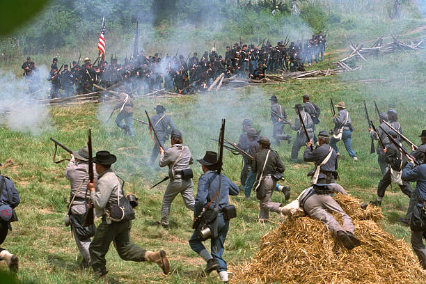Confederate Infantry Civil War Charge Against Union Position  battlefield stock pictures, royalty-free photos & images