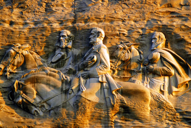 Confederate Memoiral (1925) by Augustus Lukeman on Stone Mountain Stone Mountain, GA, USA June 15, 2008 The controversial carving at Stone Mountain, Georgia depicts three Civil War Confederate Generals on the side of a mountain. robert e. lee stock pictures, royalty-free photos & images