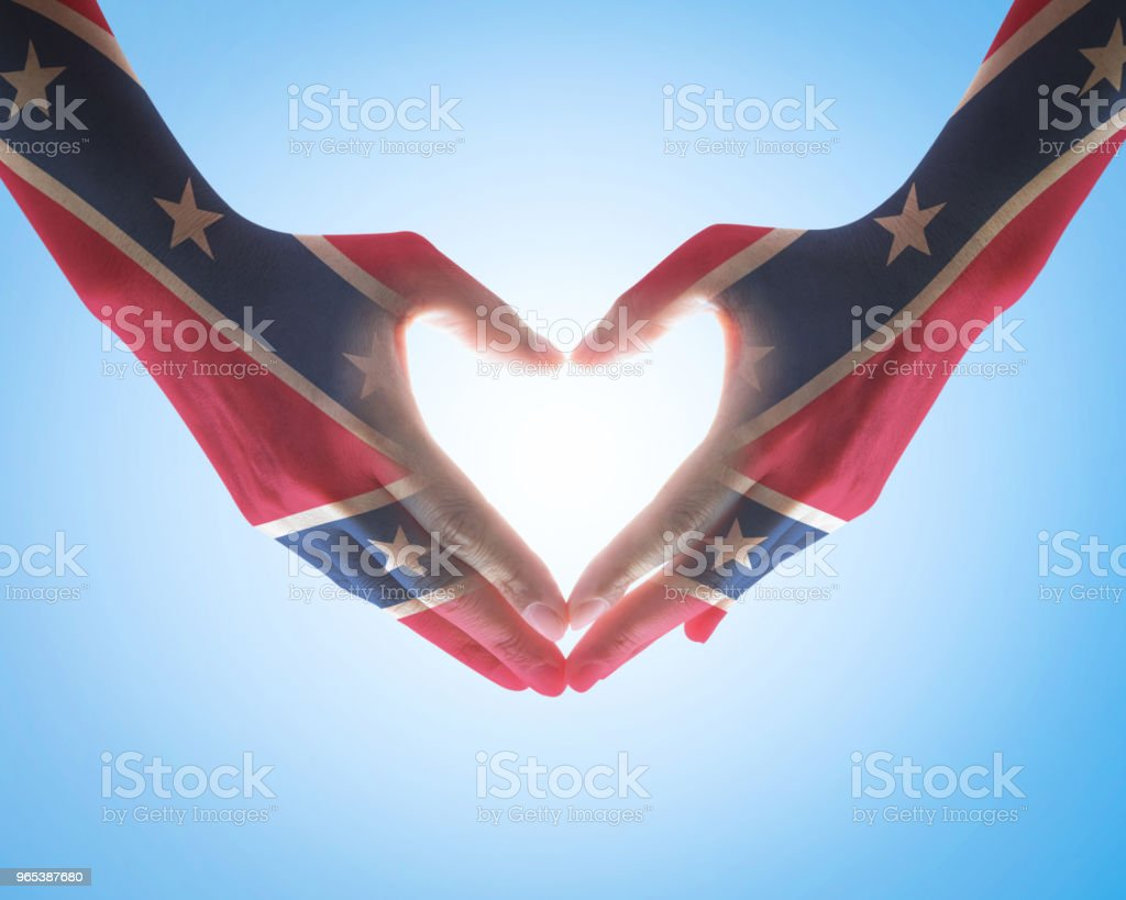 Confederate Memorial Day USA flag pattern on people heart love sign hands royalty-free stock photo