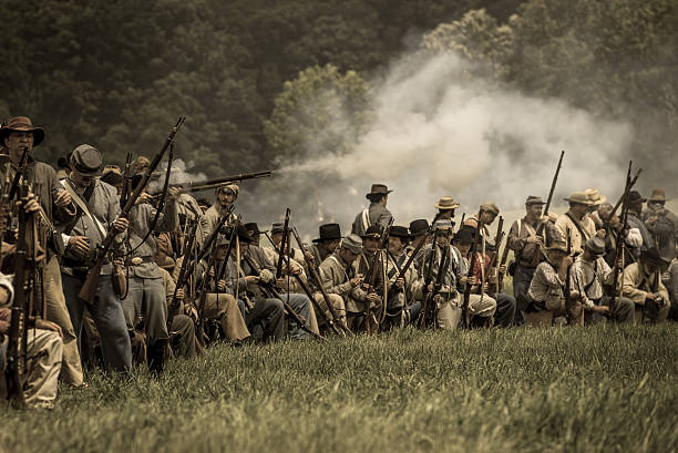 Confederate skirmish line Gettysburg, PA, USA - July 4,2013 Confederate skirmish line during battle at the 150th Anniversary of the Battle of Gettysburg Reenactment. american civil war stock pictures, royalty-free photos & images