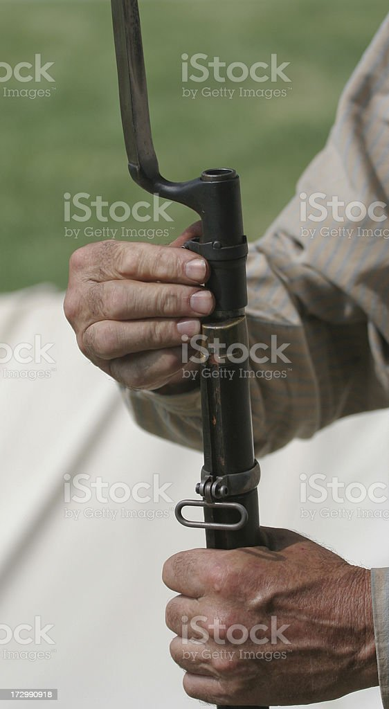 Confederate Soldier Fixing Bayonet royalty-free stock photo