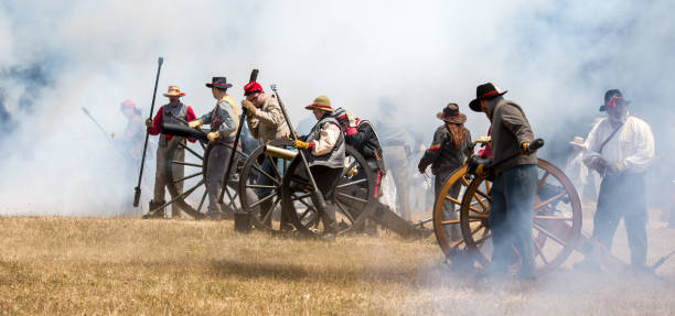 confederate soldiers fire canon - civil war stock photos and pictures