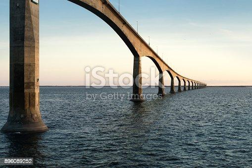 istock Confederation Bridge over sunset sky, Northumberland Strait, Prince Edward Island, Canada 896089252