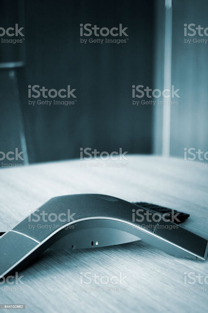Conference call speaker telephone in luxury modern office table corporate company meeting room stock photo