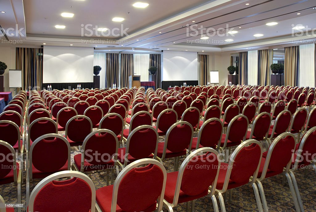Conference centre A large empty conference room with blank projector screens for your own copy. Auditorium Stock Photo