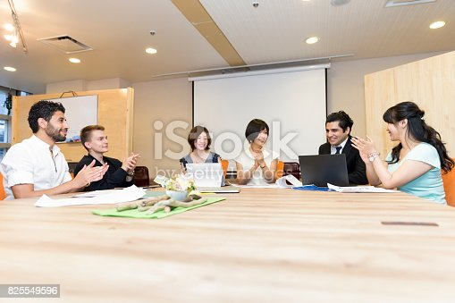 istock Conference of business executives clapping to congratulate a successful business pitch 825549596