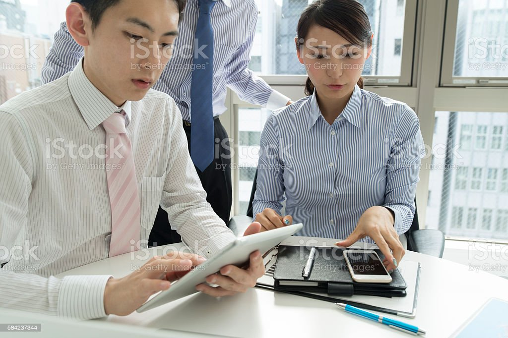 Conference of using the smart tablet. stock photo