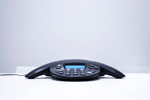 Conference phone Isolated on white table stock photo