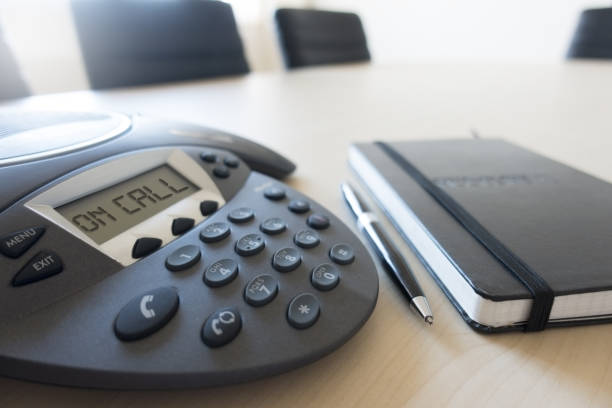 Conference phone modern equipment in meeting room Conference phone modern equipment in meeting room conference phone stock pictures, royalty-free photos & images