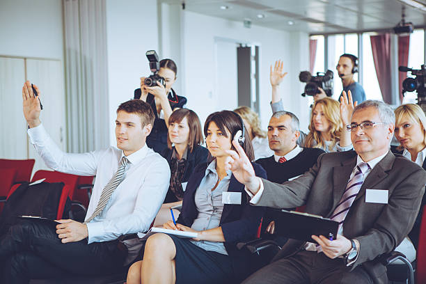 Conference. Group of business people attending press conference or presentation. press conference stock pictures, royalty-free photos & images