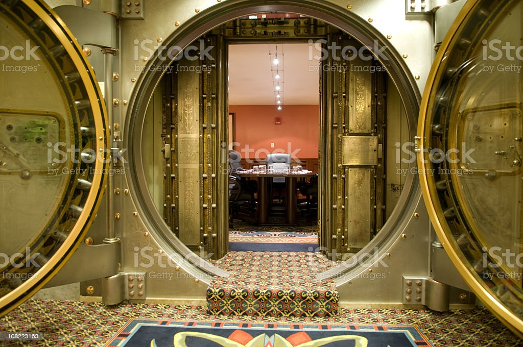 Conference Room Behind Large Metal Vault Doors stock photo