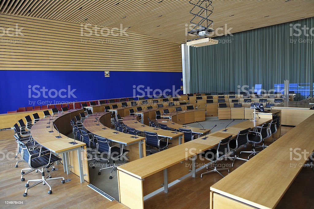 Conference Room With Chairs In A Semi Circular Layout Stock Photo - Semi circle conference table