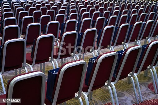 847512708 istock photo Conference room with red comfortable chairs detail and yellow floor. 810718082