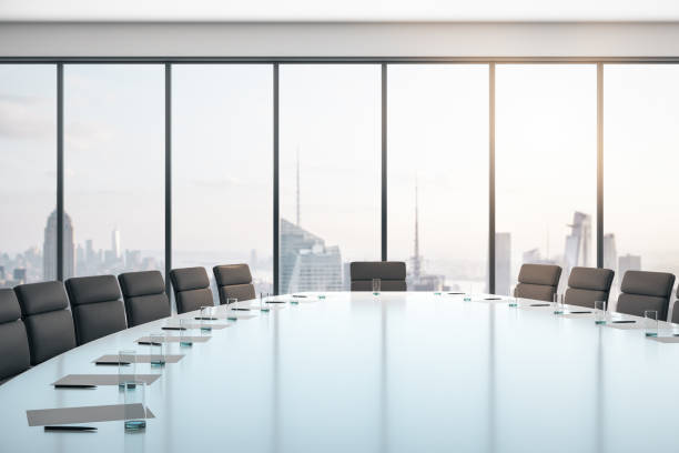 Conference room with table and chairs, large window and city view at sunrise, business concept. 3D Rendering Conference room with table and chairs, large window and city view at sunrise, business concept. 3D Rendering board room stock pictures, royalty-free photos & images