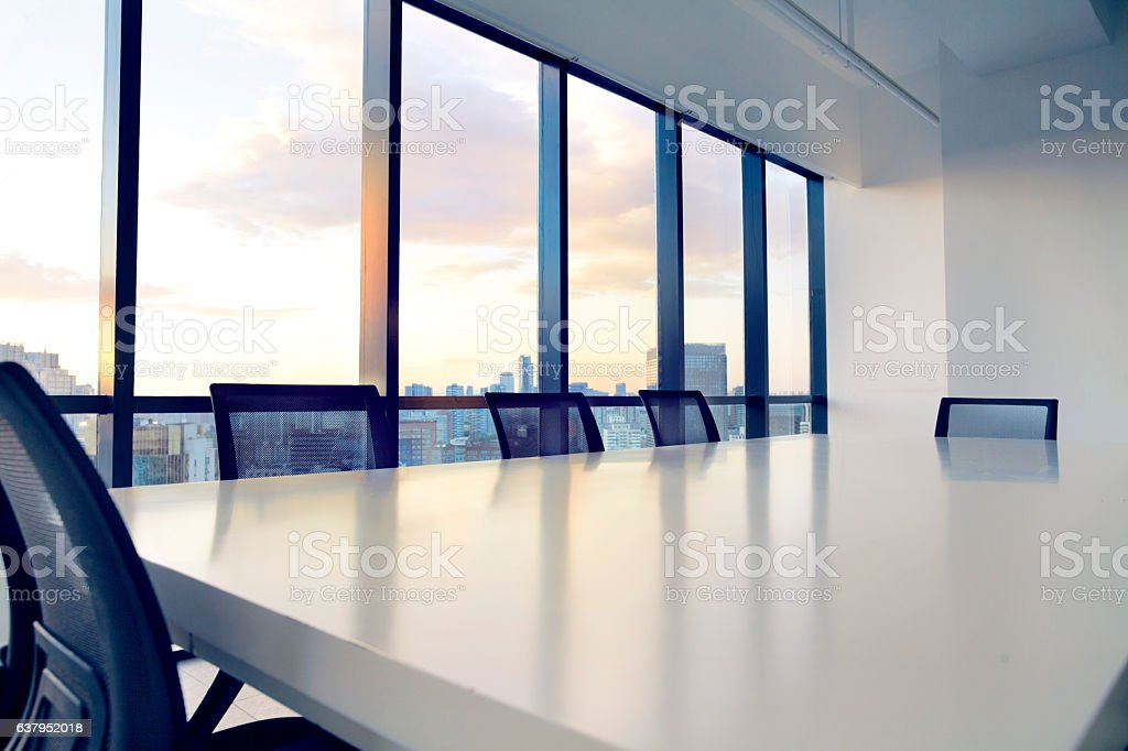 Conference table and chairs in modern office at sunset stock photo