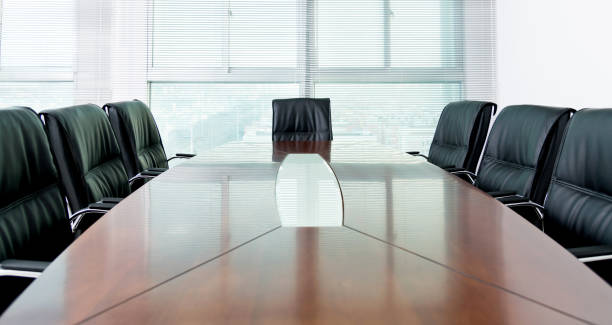 Conference table and office chair in board room Conference table and office chair in board room. governing board stock pictures, royalty-free photos & images