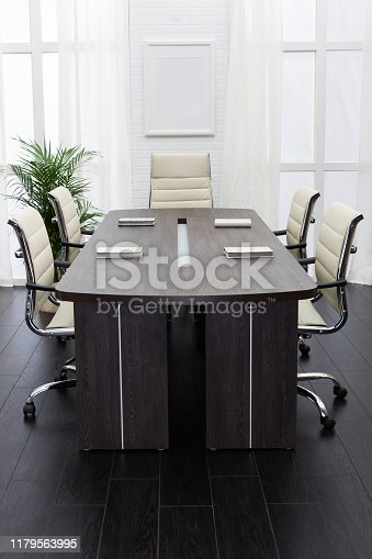847512708 istock photo conference table in a modern office 1179563995