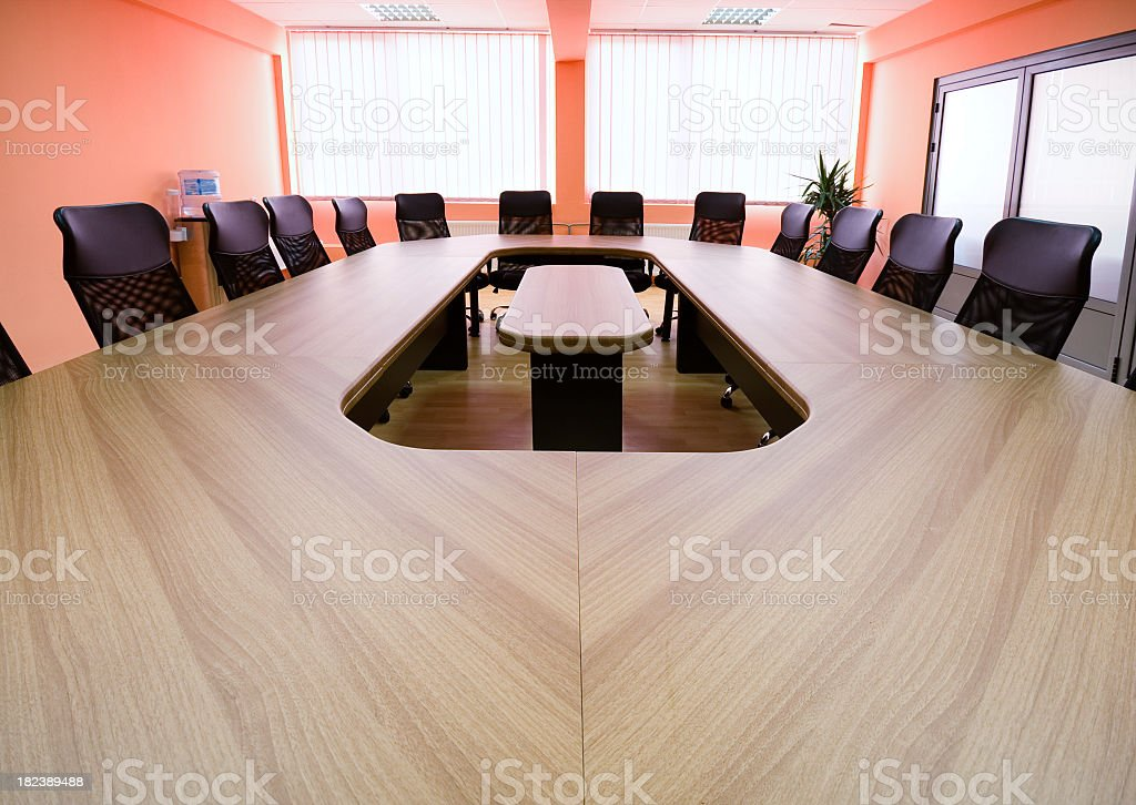 Conference table in large board room royalty-free stock photo