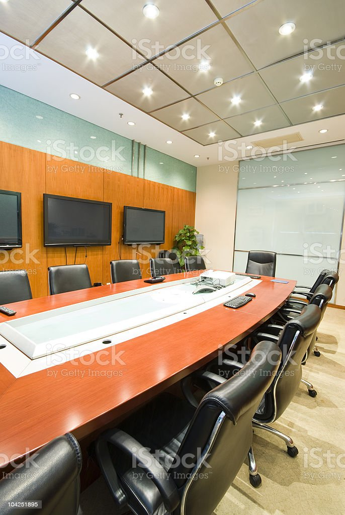 Conference table in modern office boardroom stock photo