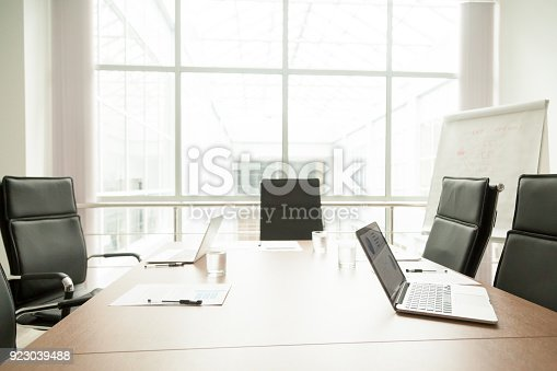 istock Conference table in office of modern business center, boardroom interior 923039488