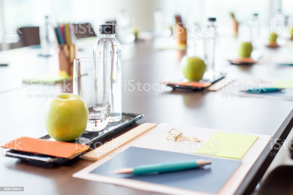 Conference Table With Water and Stationery stock photo