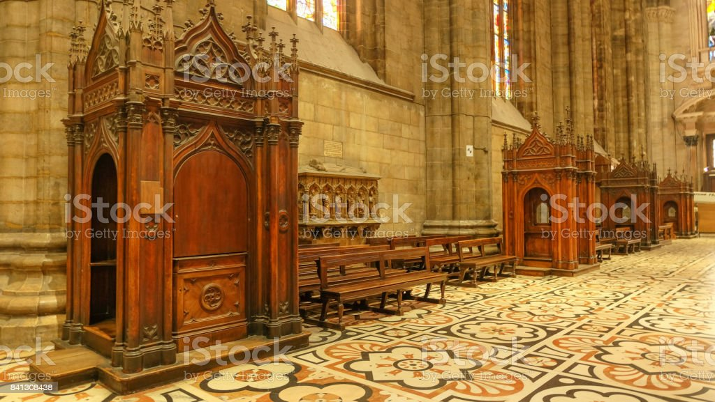 Confession booths at Duomo in Milan, Italy stock photo