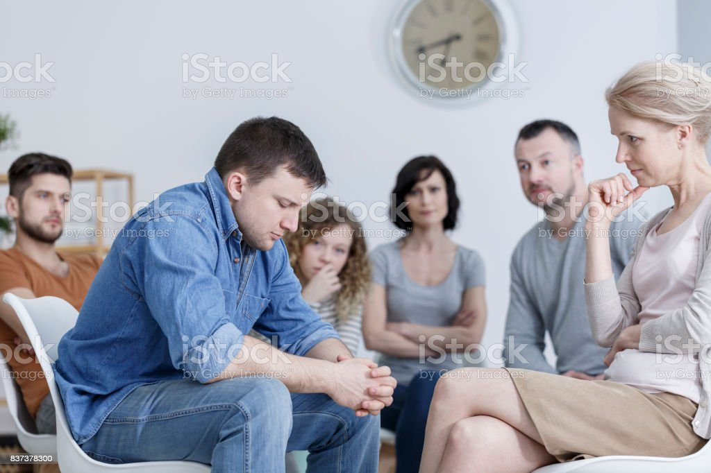 Confession during support group stock photo