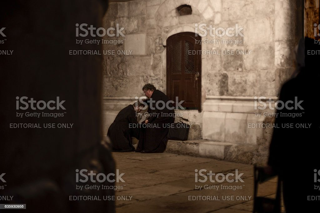 Confession in the Church of HOly Sepulchre stock photo