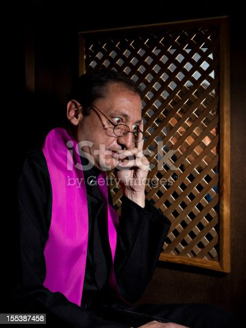 Priest in a confessional, surprised the sins of a parishioner