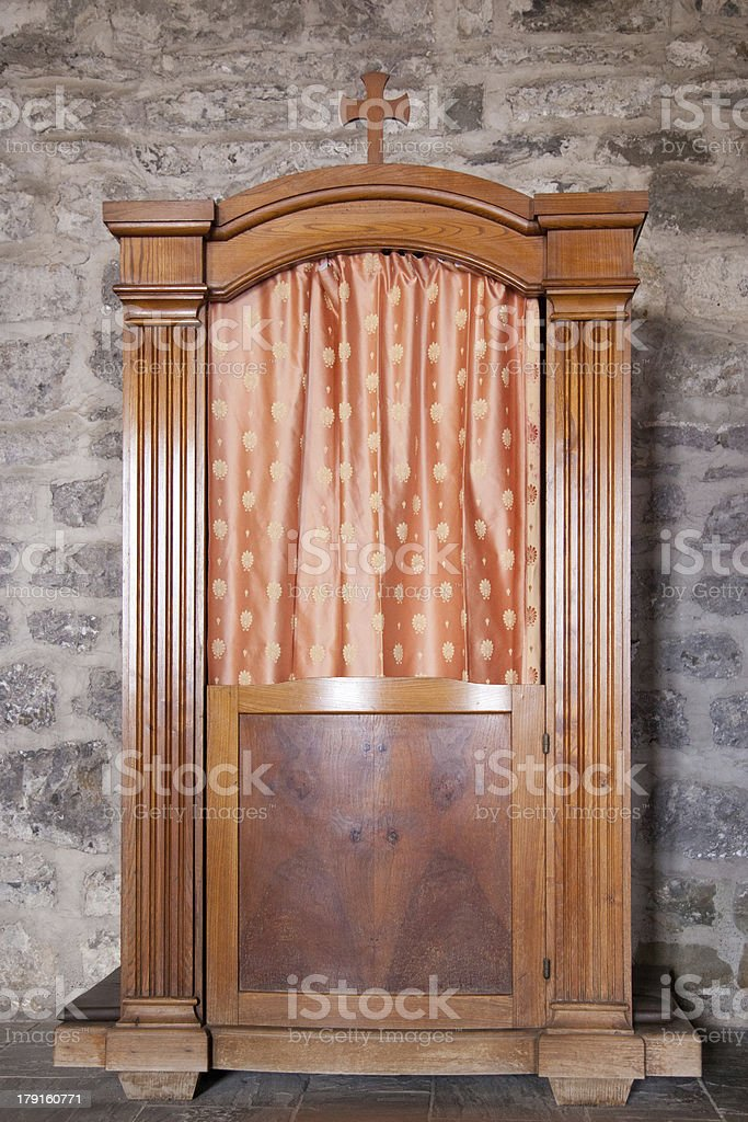 confessional in old church royalty-free stock photo