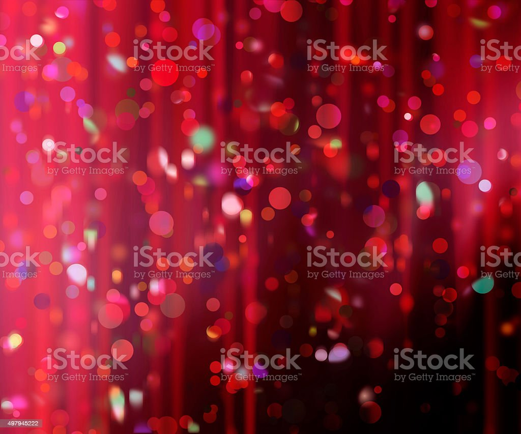 confetti against a blurred curtain background stock photo