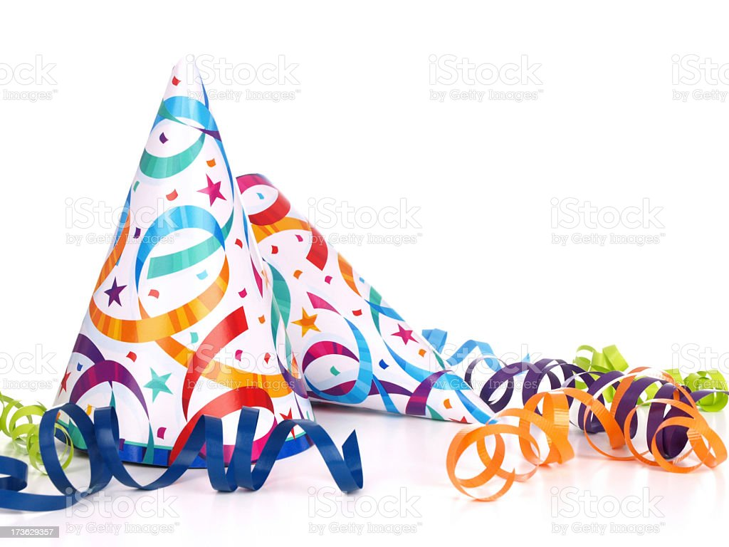 Confetti and streamer printed conical party hats stock photo